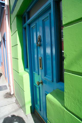 Blue-door-green-building