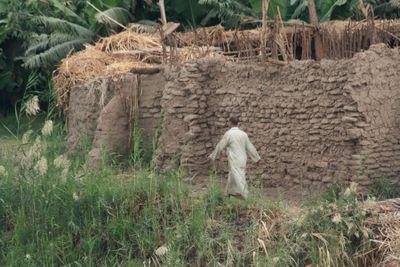 Man-walking-along-Nile