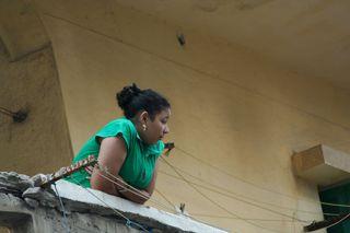 Alexandrian-woman-on-porch