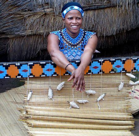 Woman-weaving-mat